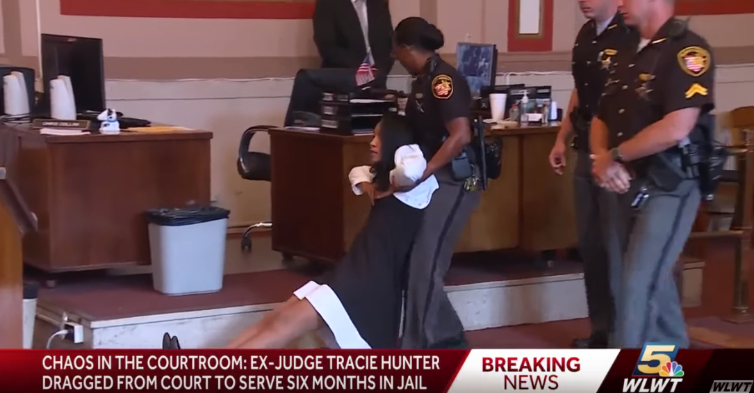 ex-judge tracie hunter being dragged out of court