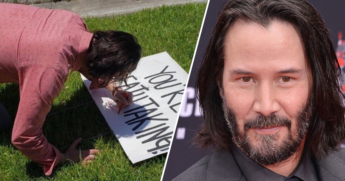 keanu reeves signs a sign left behind by a fan