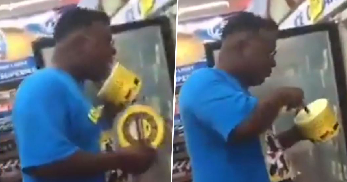 Guy licks ice cream and puts it back on shelf