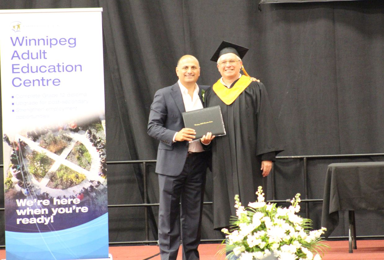 Dad graduates after being bullied out of school