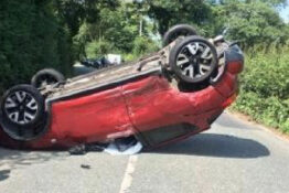 overturned car after wasp reportedly caused 3 car crash