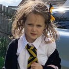 Hilarious Photos Show First Day At School Taking Its Toll On Little Girl