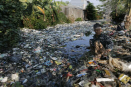 Shocking Photos Show Mile-Long Stretch Of River Clogged With 400 Tonnes Of Rubbish In Indonesia