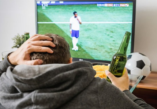 man Watching football