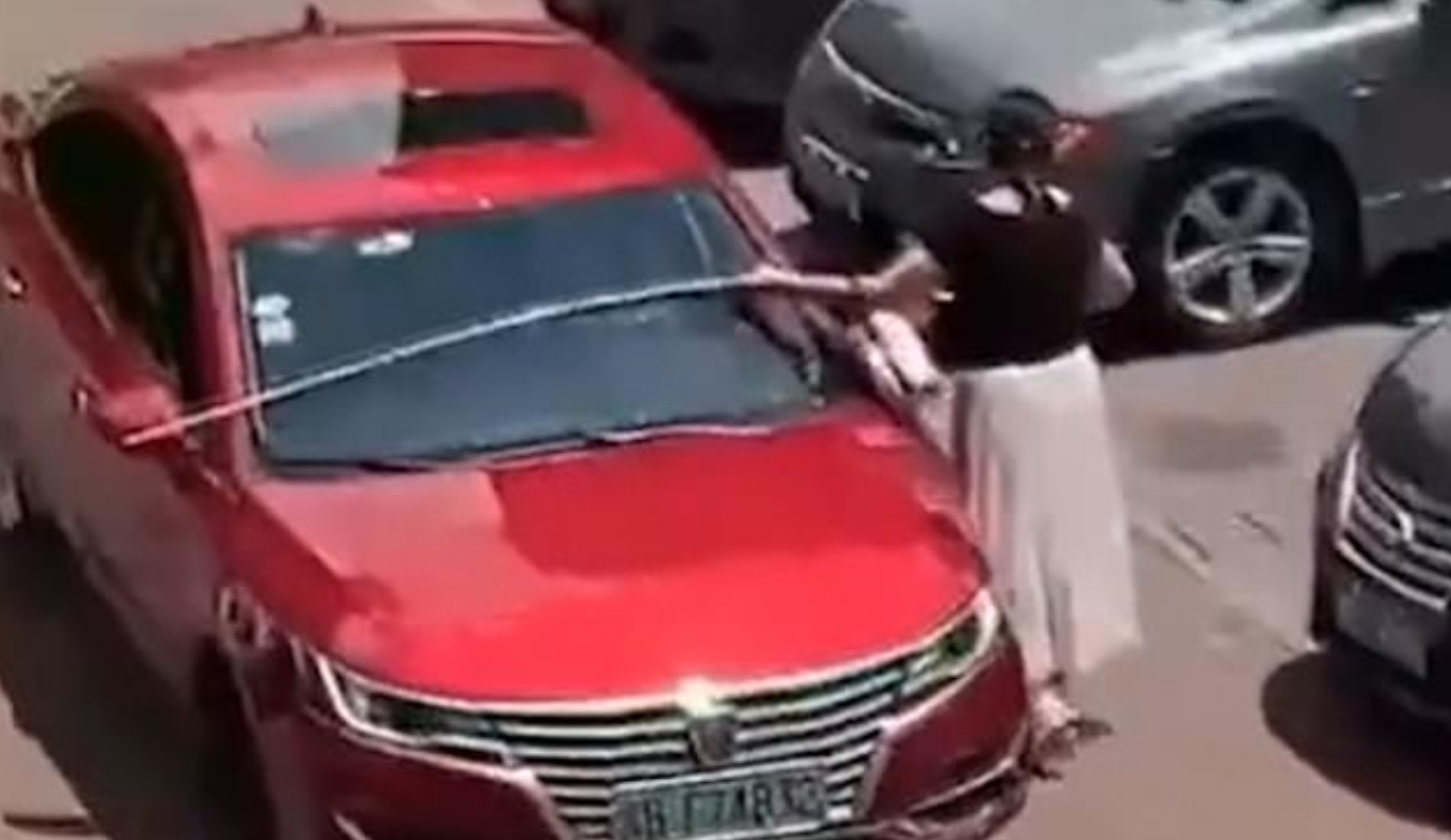 'World's Most Careful Driver' Caught Using Tape Measure To Check She Fits In Parking Space