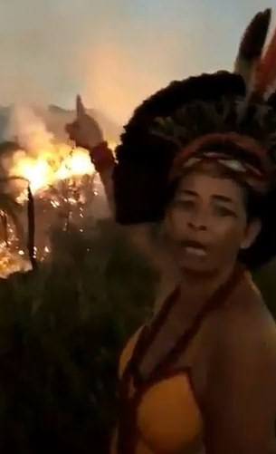 Indigenous Brazilian Woman Cries As Amazon Rainforest Burns Behind Her