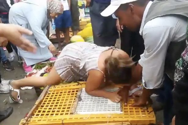 British Woman Filmed Biting Chicken Sellers Hand While Trying To Free Bird