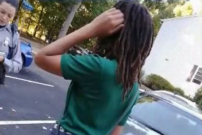 Student pinned down and had dreadlocks cut off by classmates