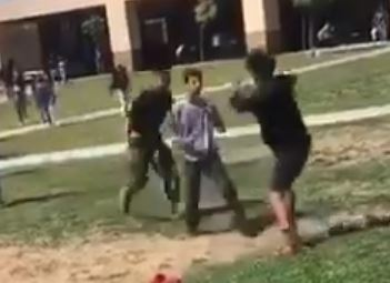 Marine tackles two boys to ground to break up fight