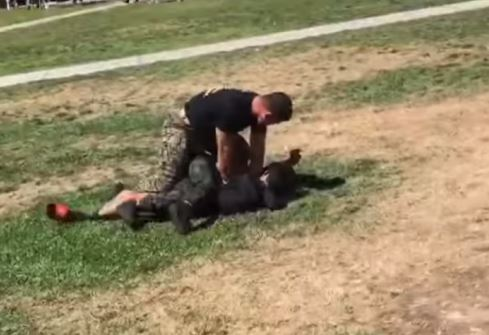 Marine tackles two boys to the ground to break up fight