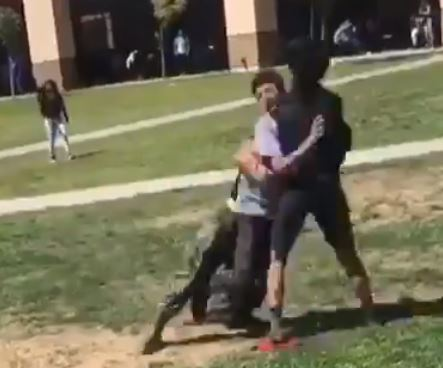 Marine tackles two boys to break up fight