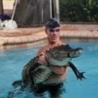 Florida Man Wrestles Massive Alligator Out Of Swimming Pool