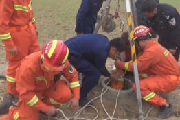 Rescuers work to save woman trapped in well