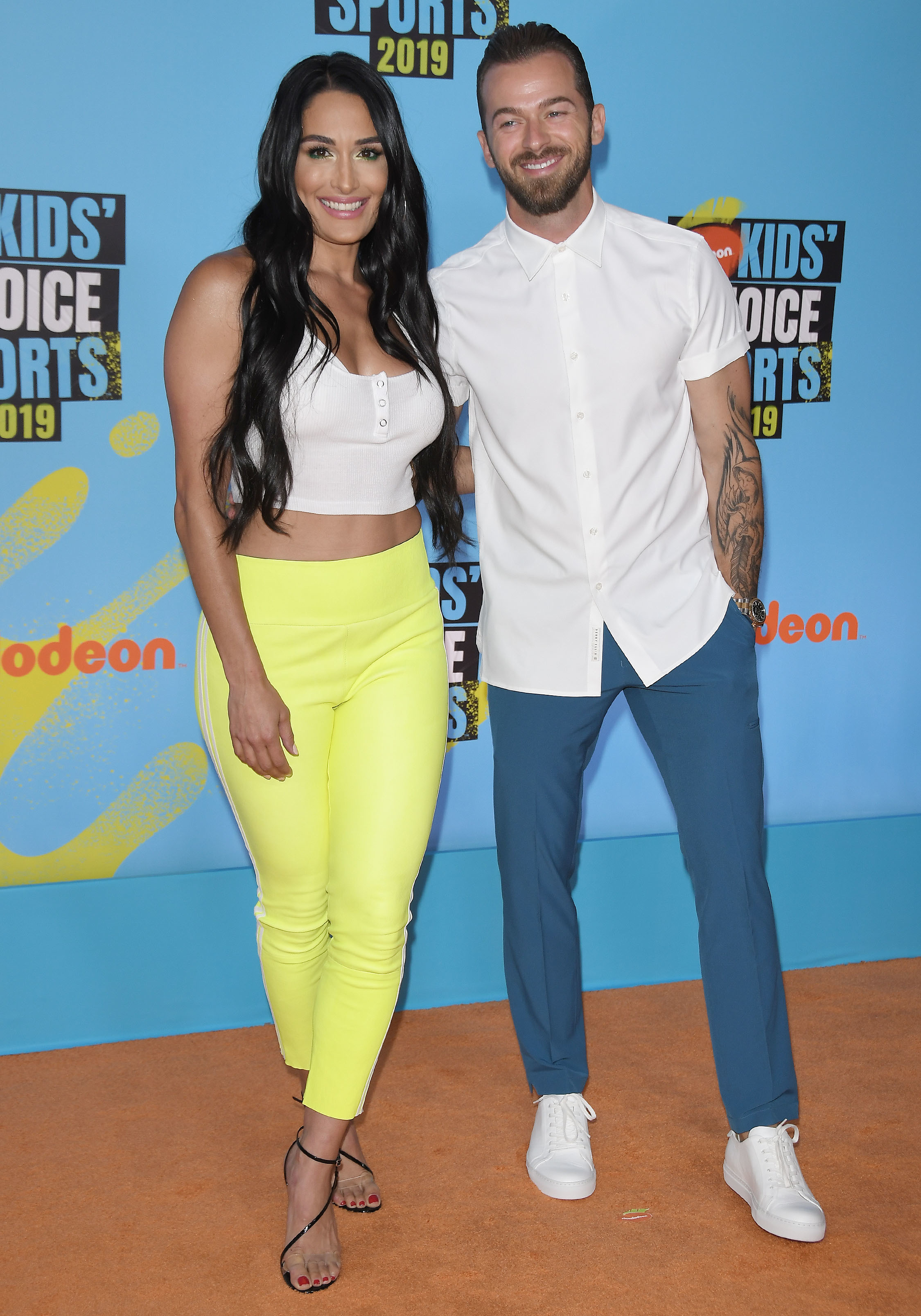 (L-R) Nikki Bella and Artem Chigvintsev