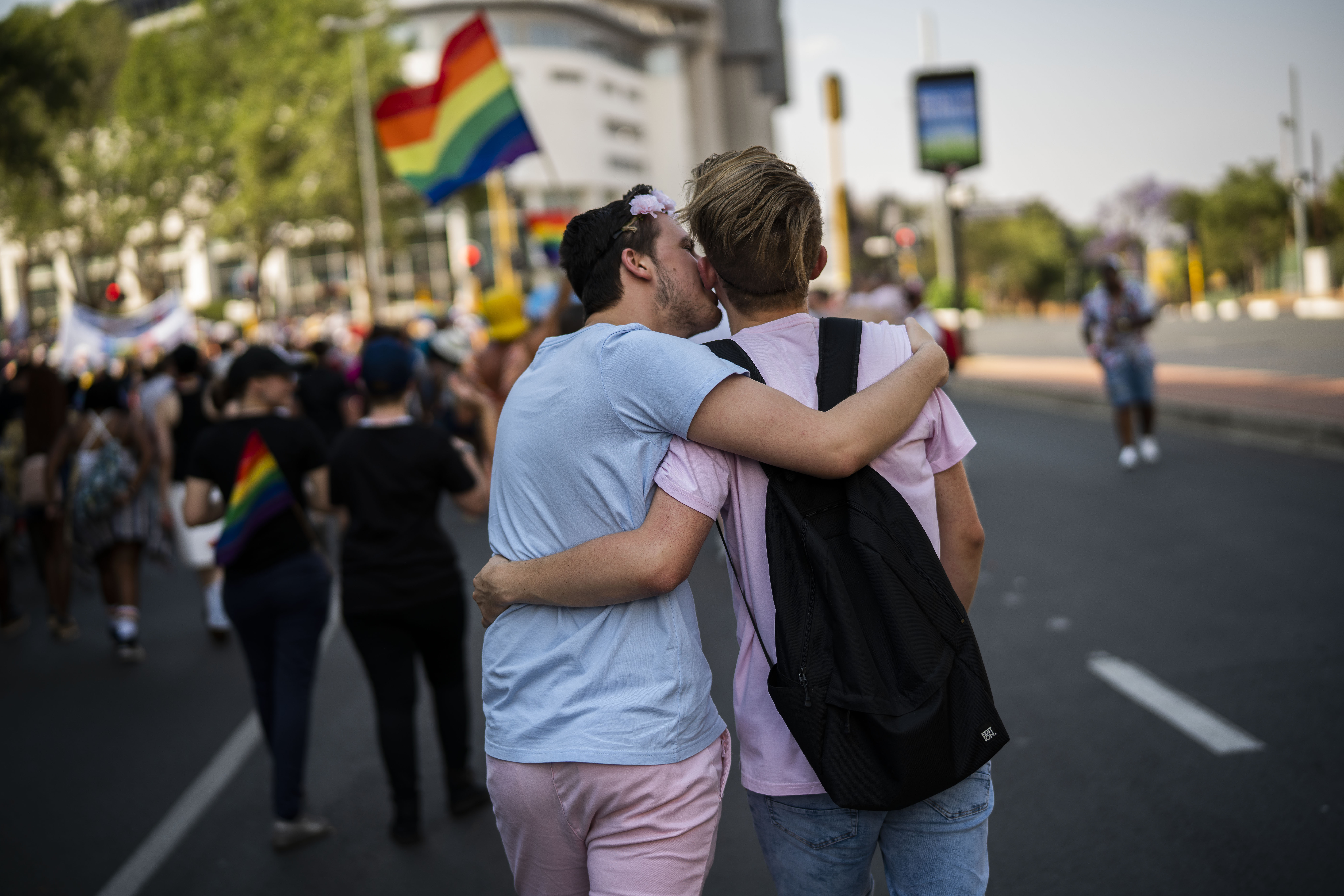 Couple hugging at pride