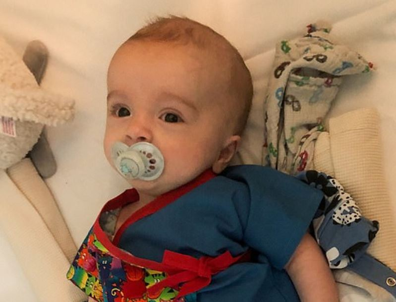 Baby wakes up from coma and smiles up at his parents