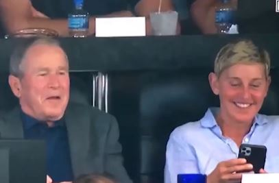 Ellen and George Bush at football game