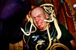 Guy with snakes on head at world's scariest haunted house