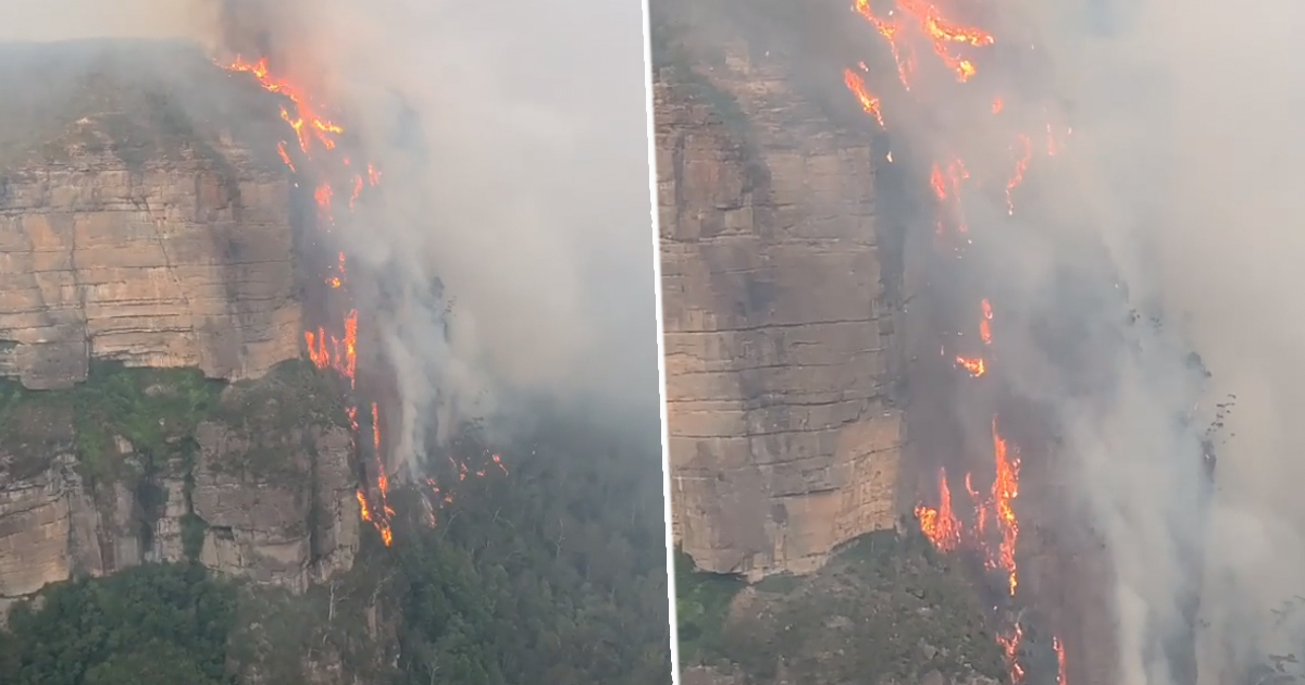 'Lava Waterfall' Clings To Side Of Cliff As Wildfire Burns Through New South Wales