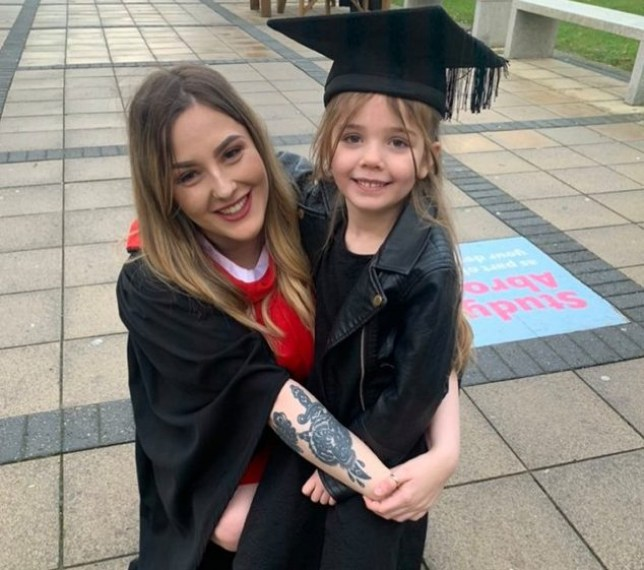 Mum Asked To Leave School After Pregnancy At 14 Graduates Uni Holding Daughter's Hand