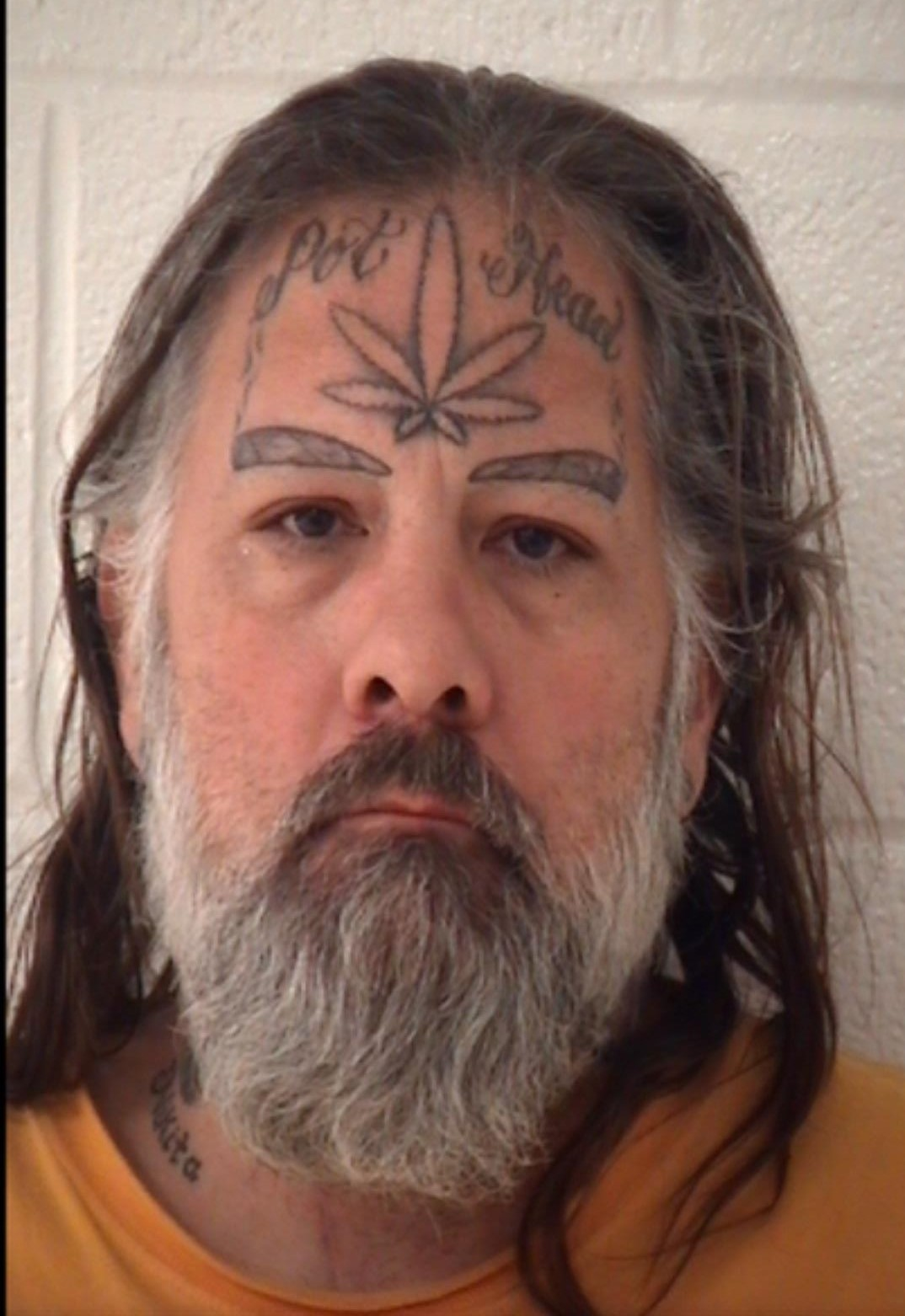 man has pot head tattoo