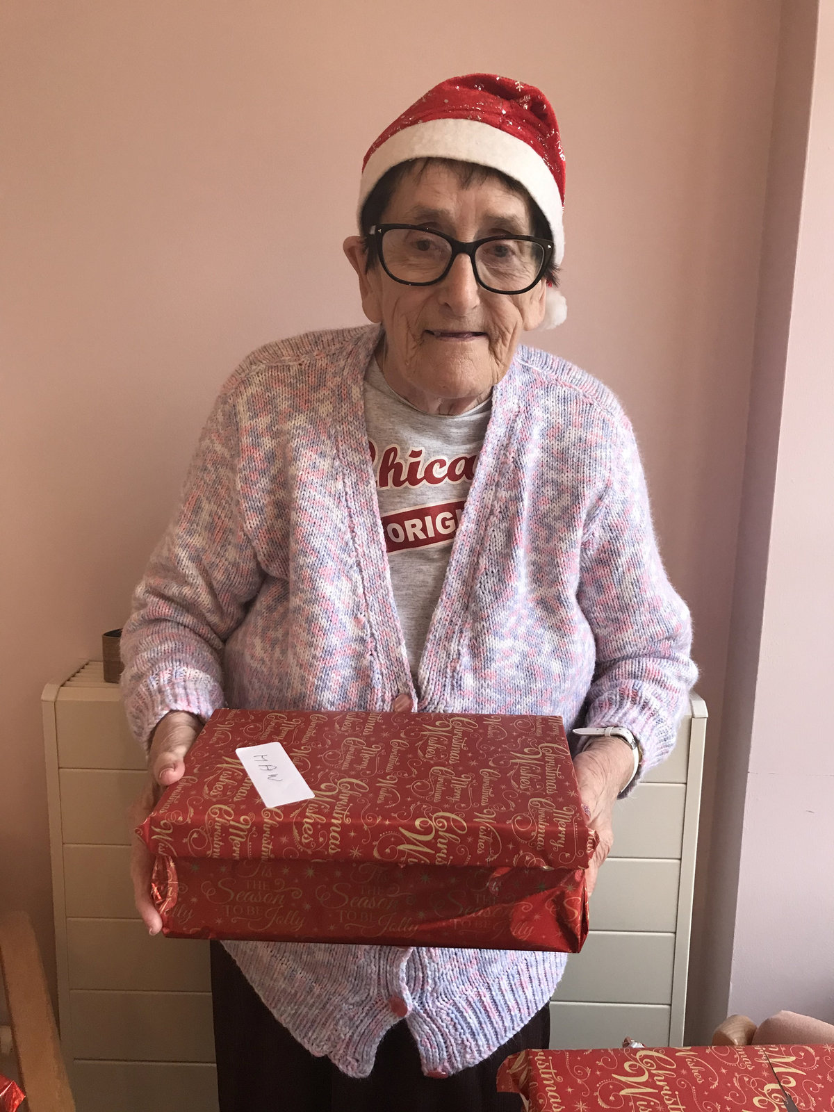 Grandmother holds up gift-filled shoebox created for people in need