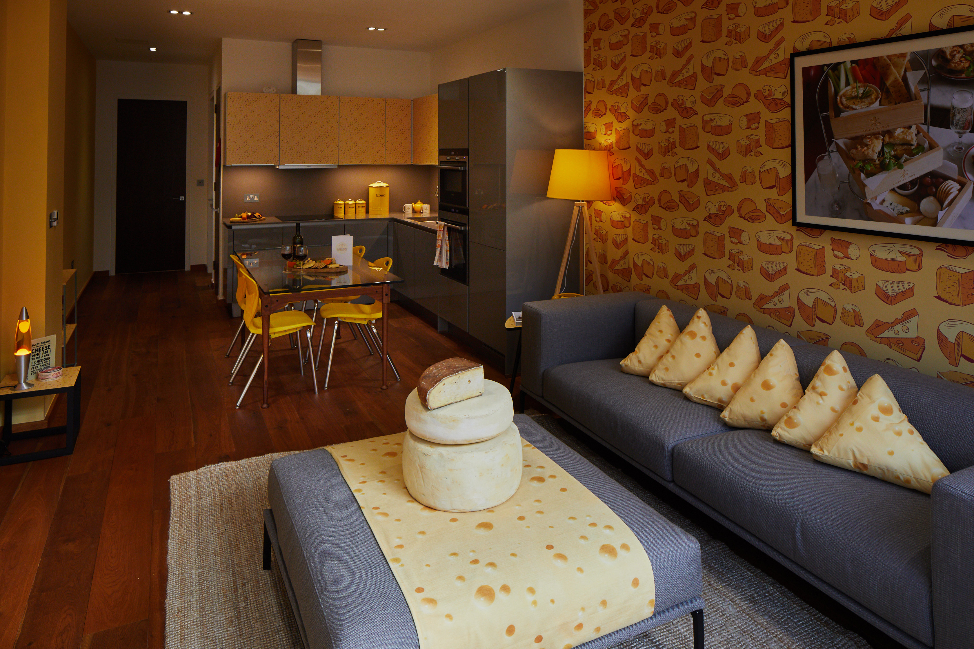 Cheese-themed cushions in cheese-themed hotel suite