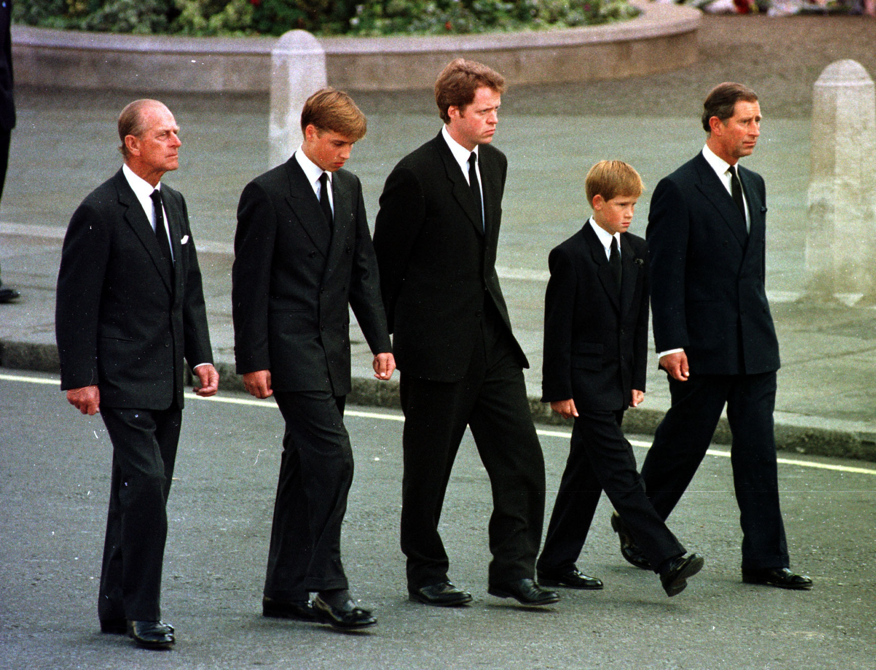 prince harry with royal family at funeral of princess diana