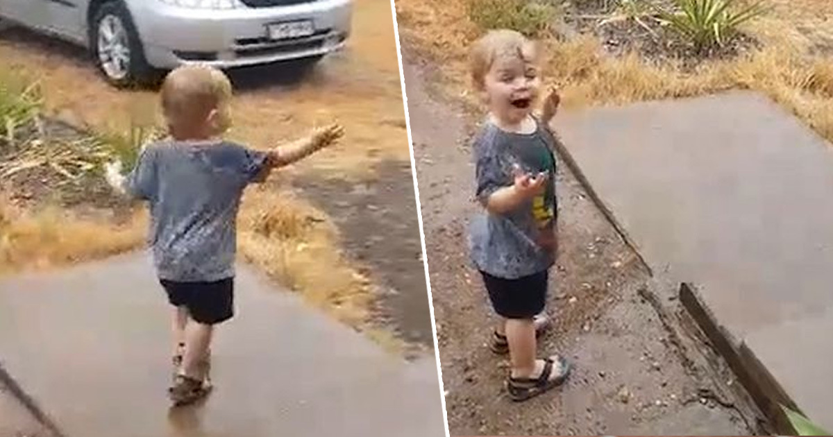 Little boy dances in rain