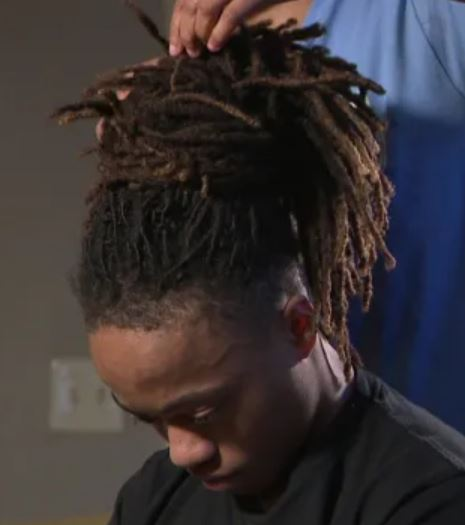 boy with dreadlocks suspended from school