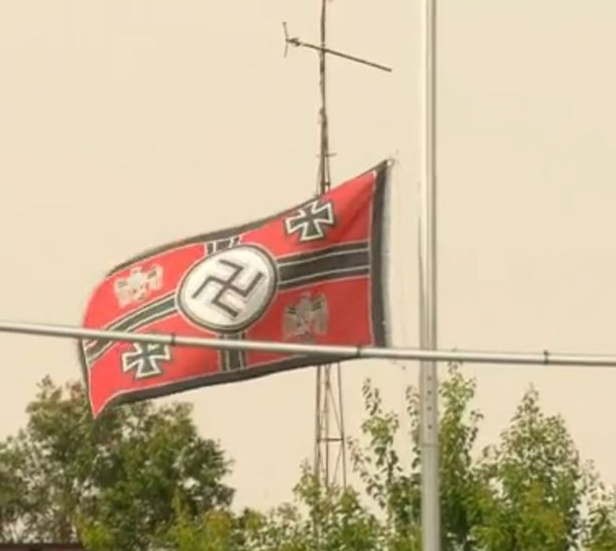 Couple Refuse To Take Down Nazi Flag Flying Across From Home Of Holocaust Survivor