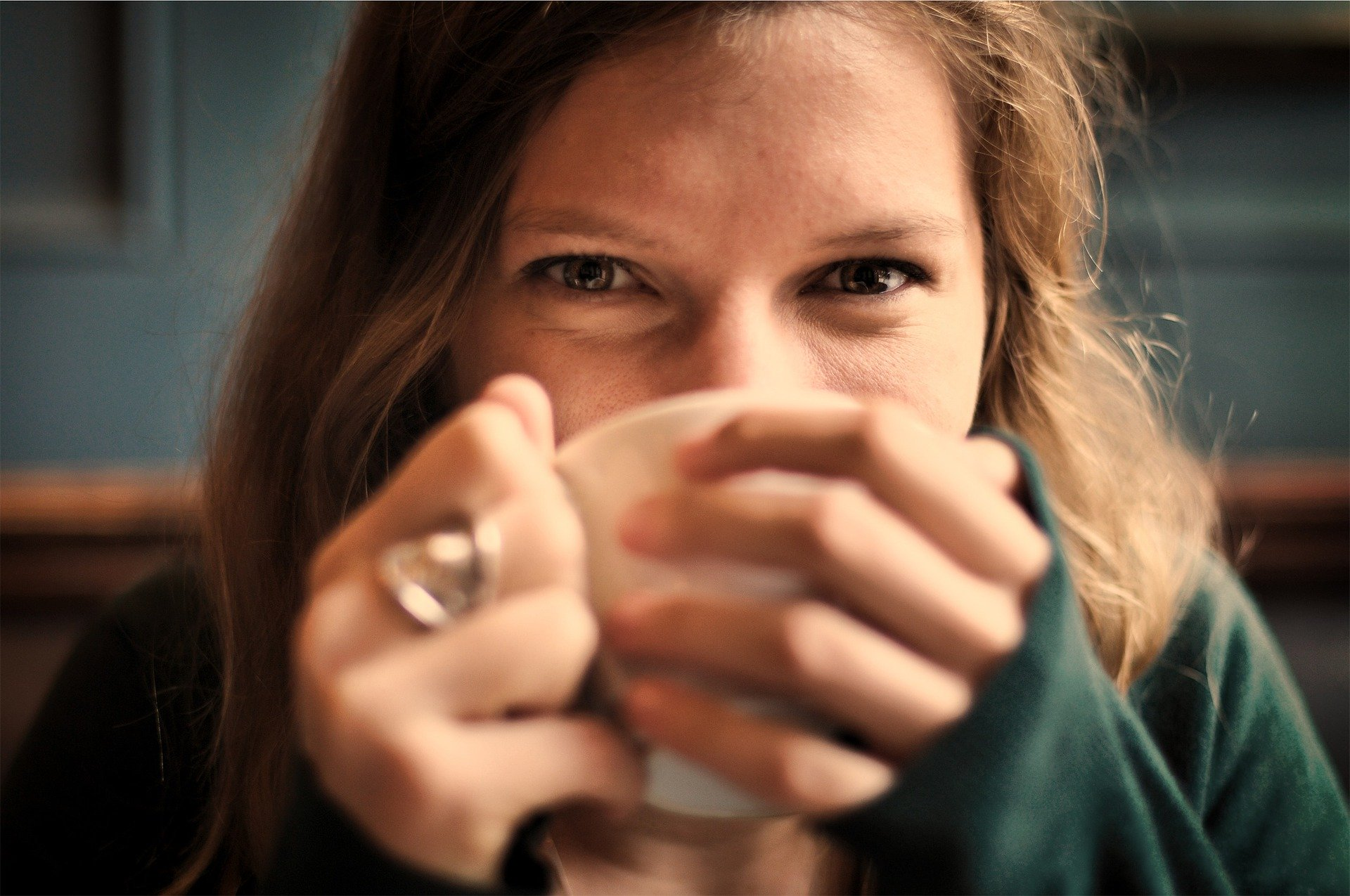 girl drinking cup of tea