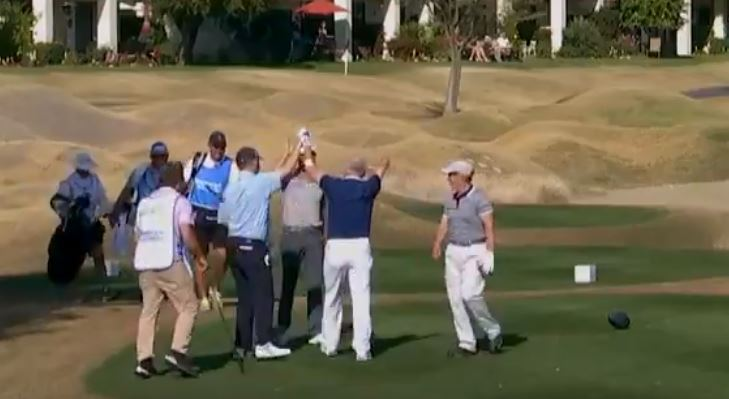 golfer with one arm puts hole in one