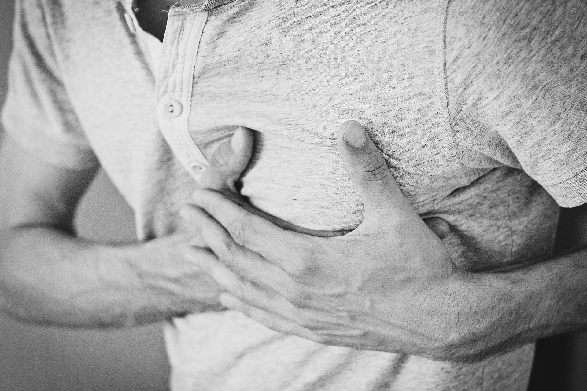 Person clutching chest in pain
