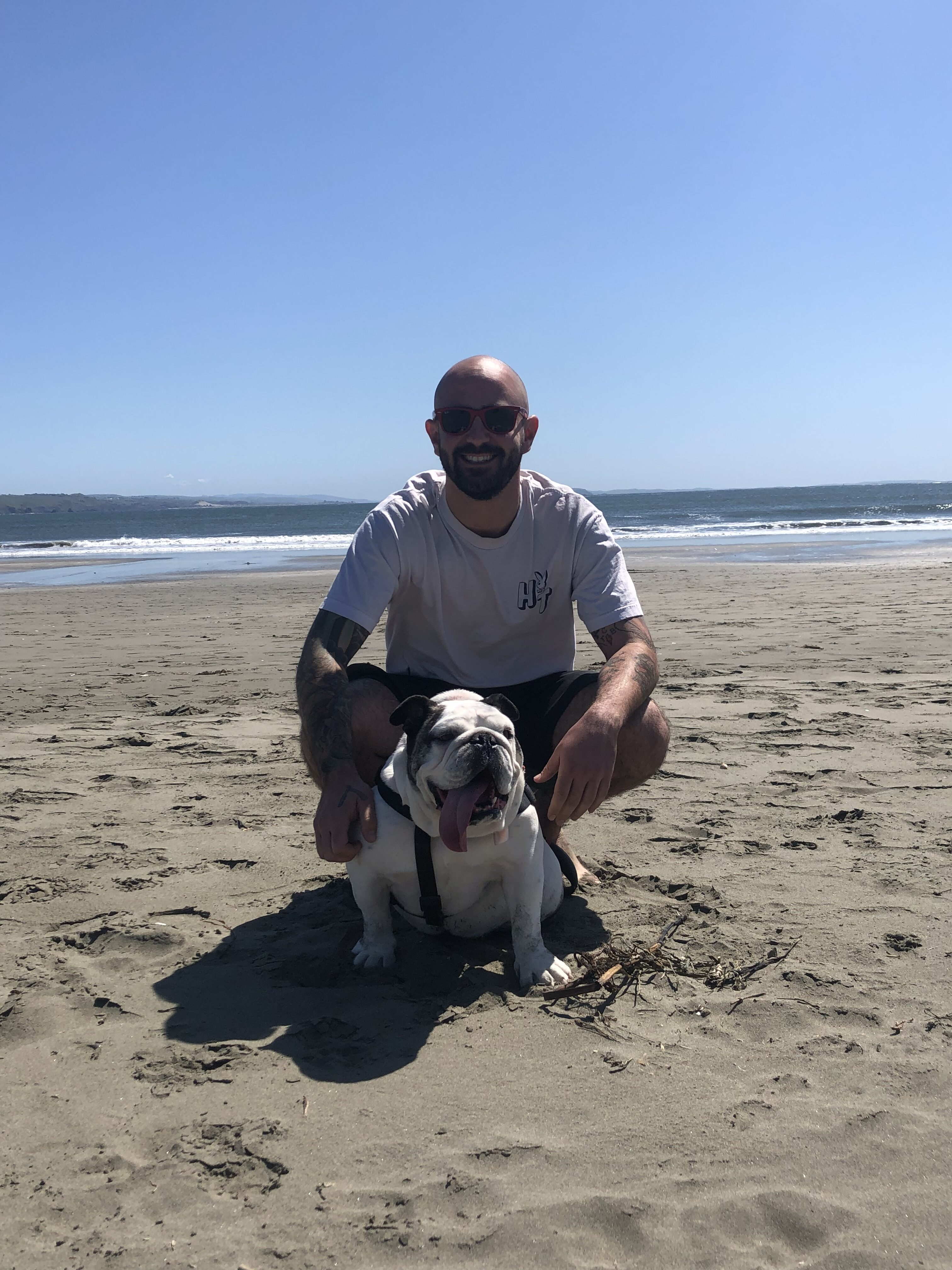 Alex Tillisch on the beach with his dog after more than one year sober