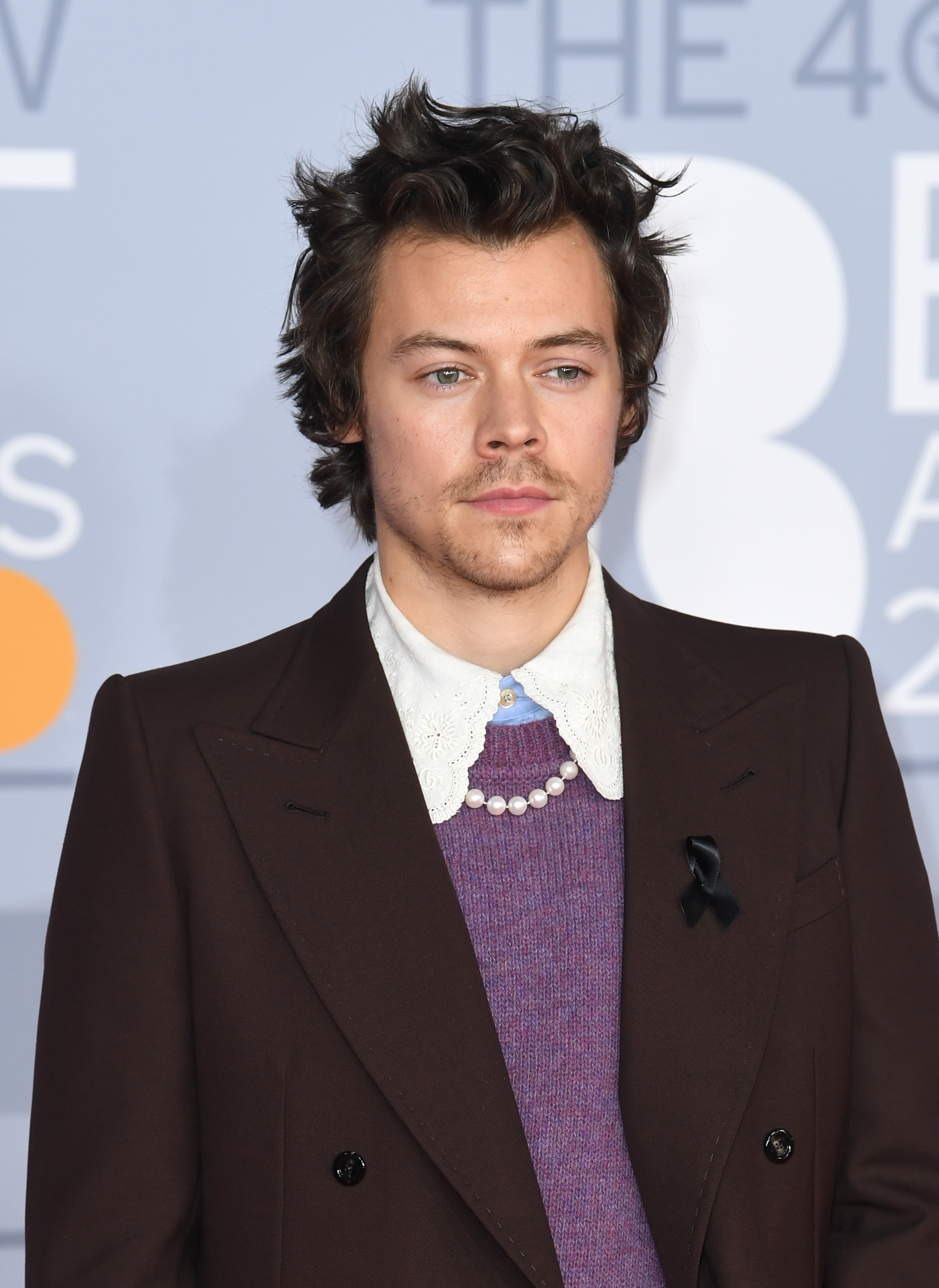 Harry Styles wears black ribbon in tribute to Caroline Flack at BRITs