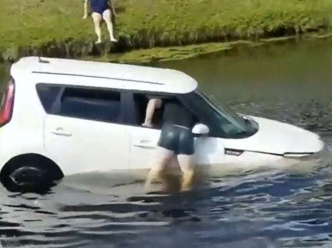 Dad Swims Into Sinking Car To Rescue Woman Suffering Seizure Behind Wheel
