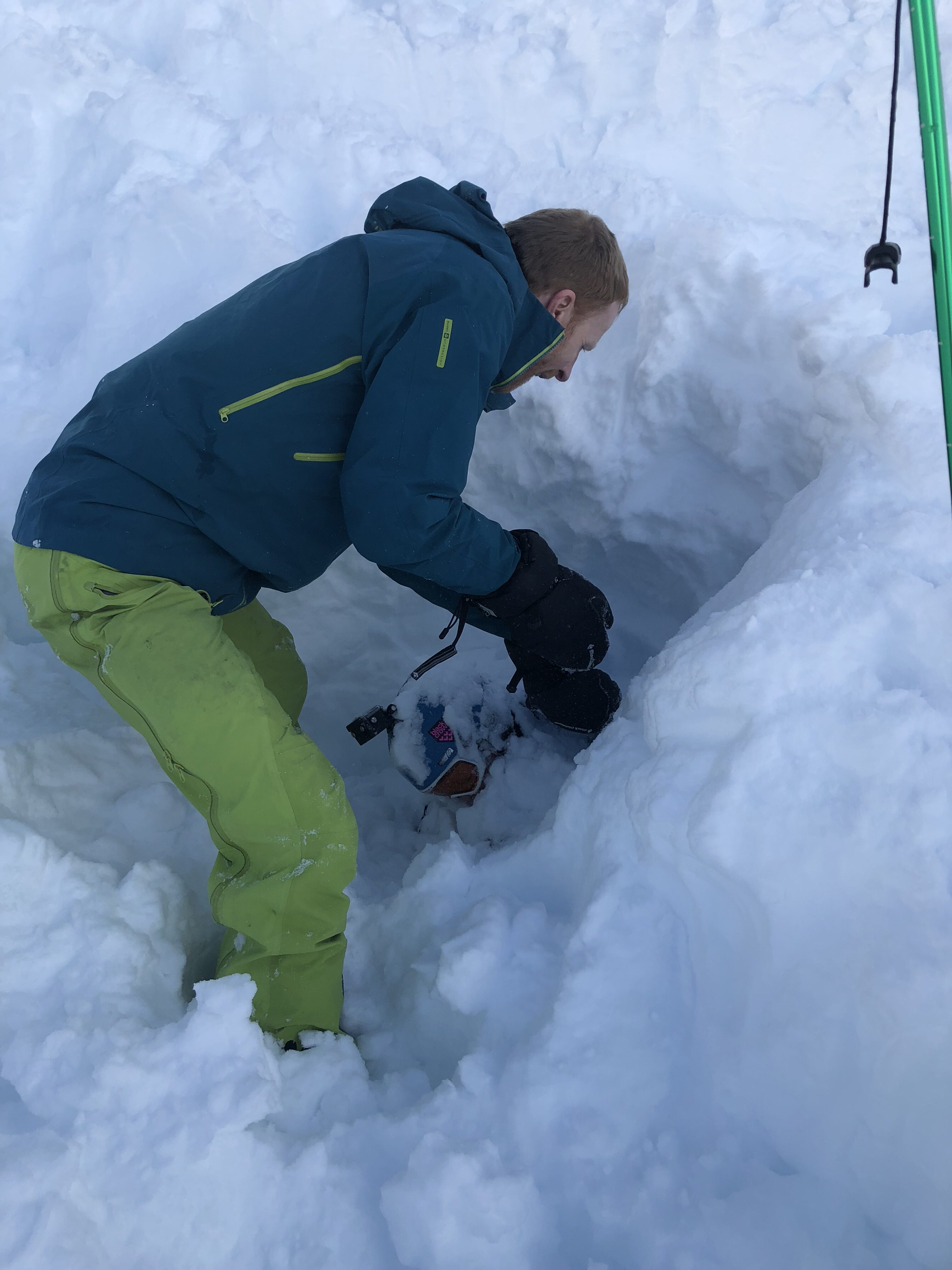 Dad digging son out of snow after he was buried