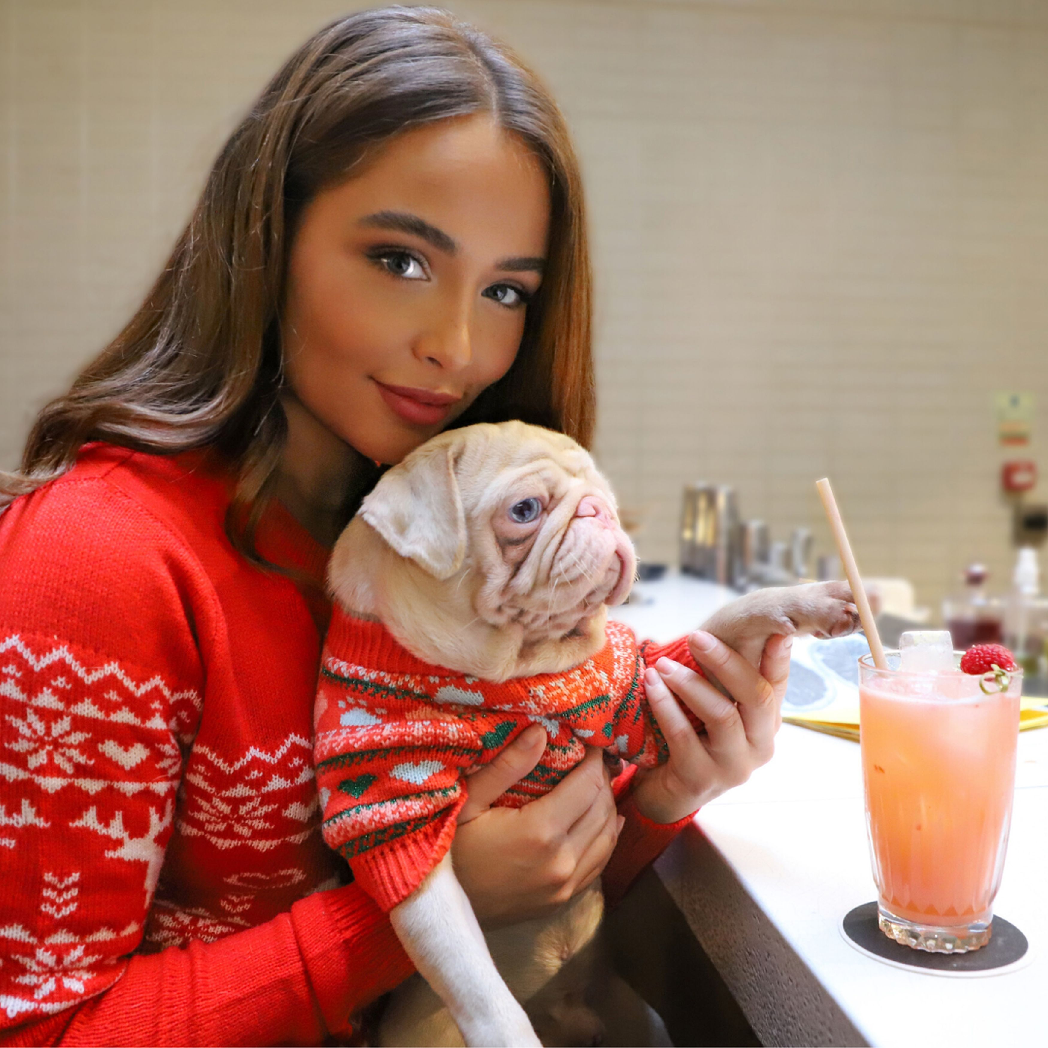 Owner Maria with pink pug Milkshake