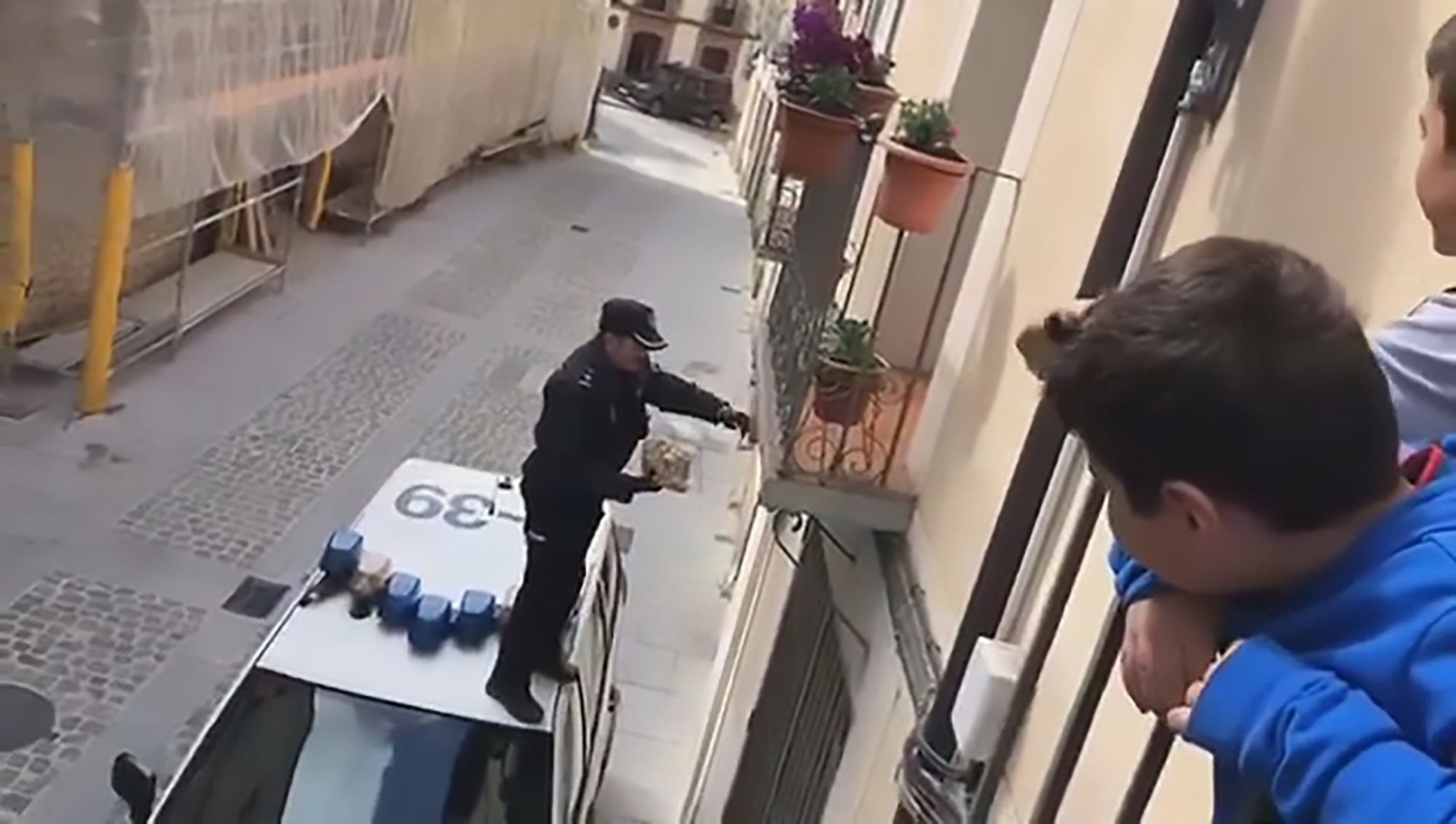 Police Officer climbs on top of car