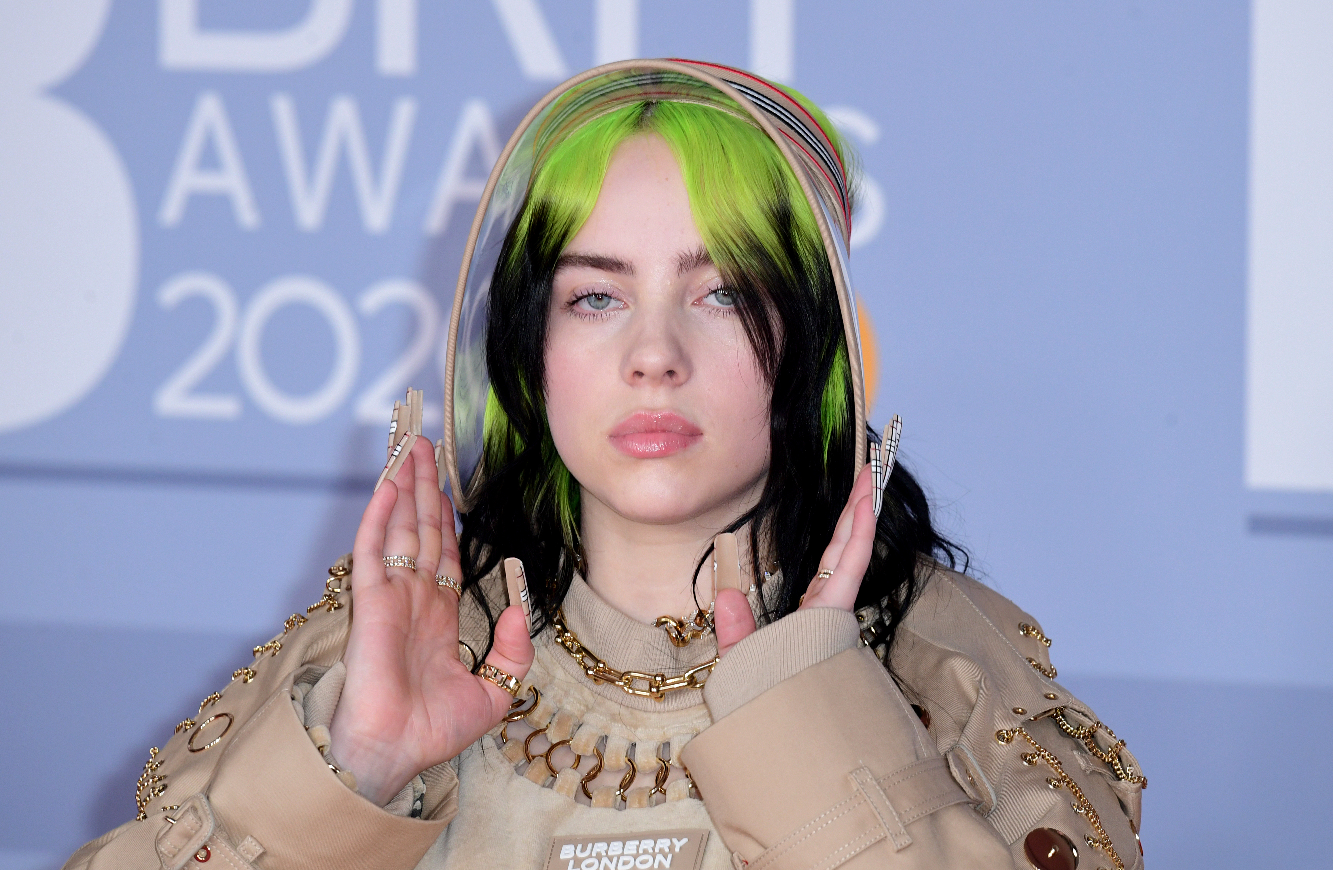 Billie Eilish Confronts Body Shamers By 'Shedding Layers' Of Clothes On Stage