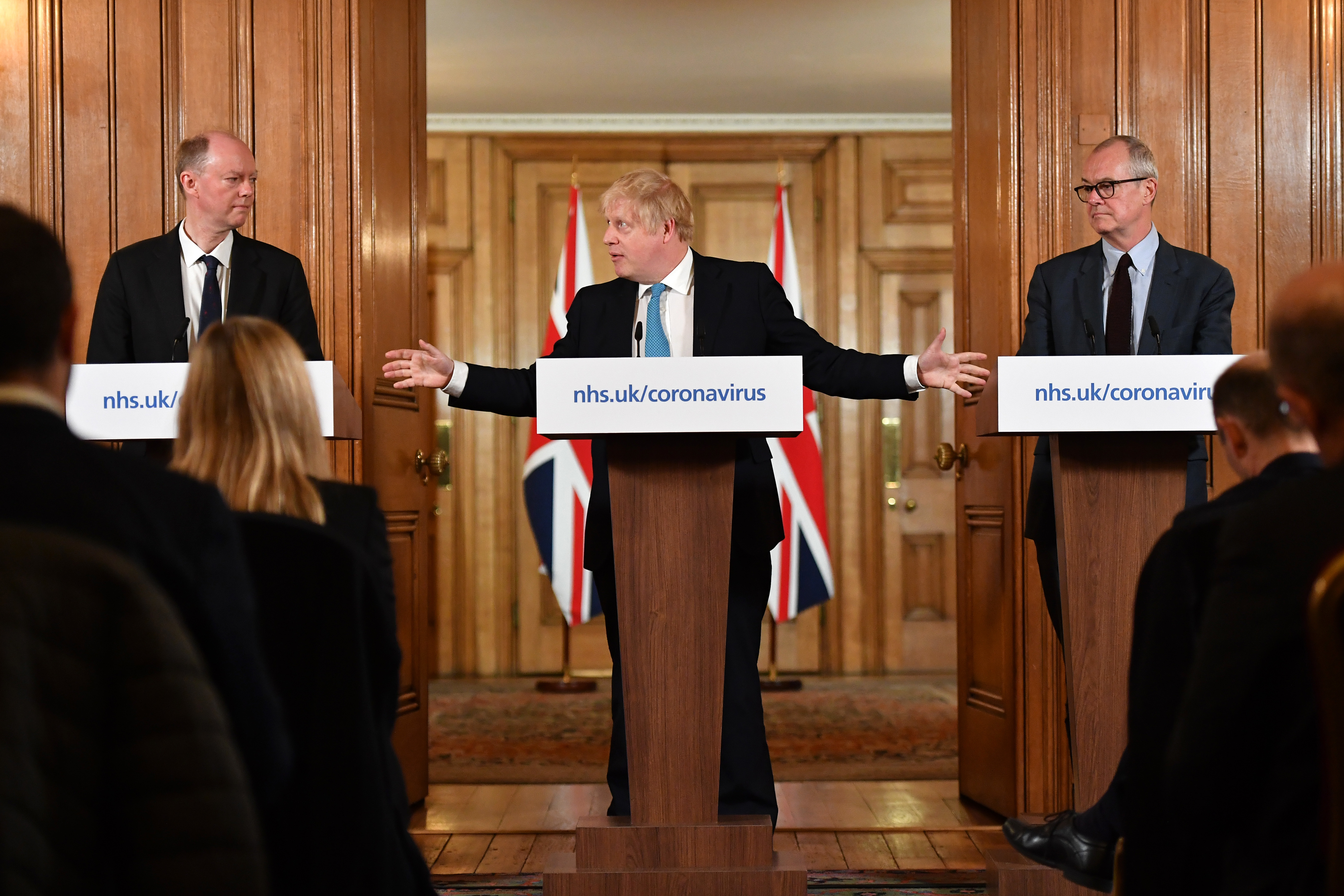 Chief Medical Officer Professor Chris Whitty (left) and Chief Scientific Adviser Patrick Vallance (Right) watch as Prime Minister Boris Johnson