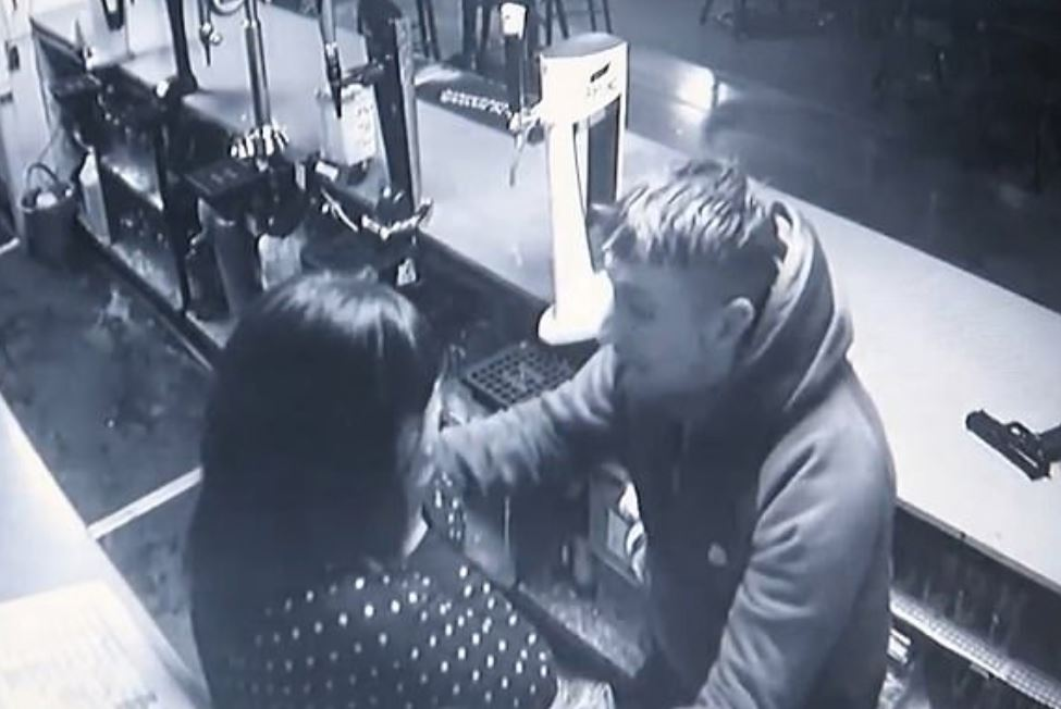 Robber removes his mask after bartender recognises his voice
