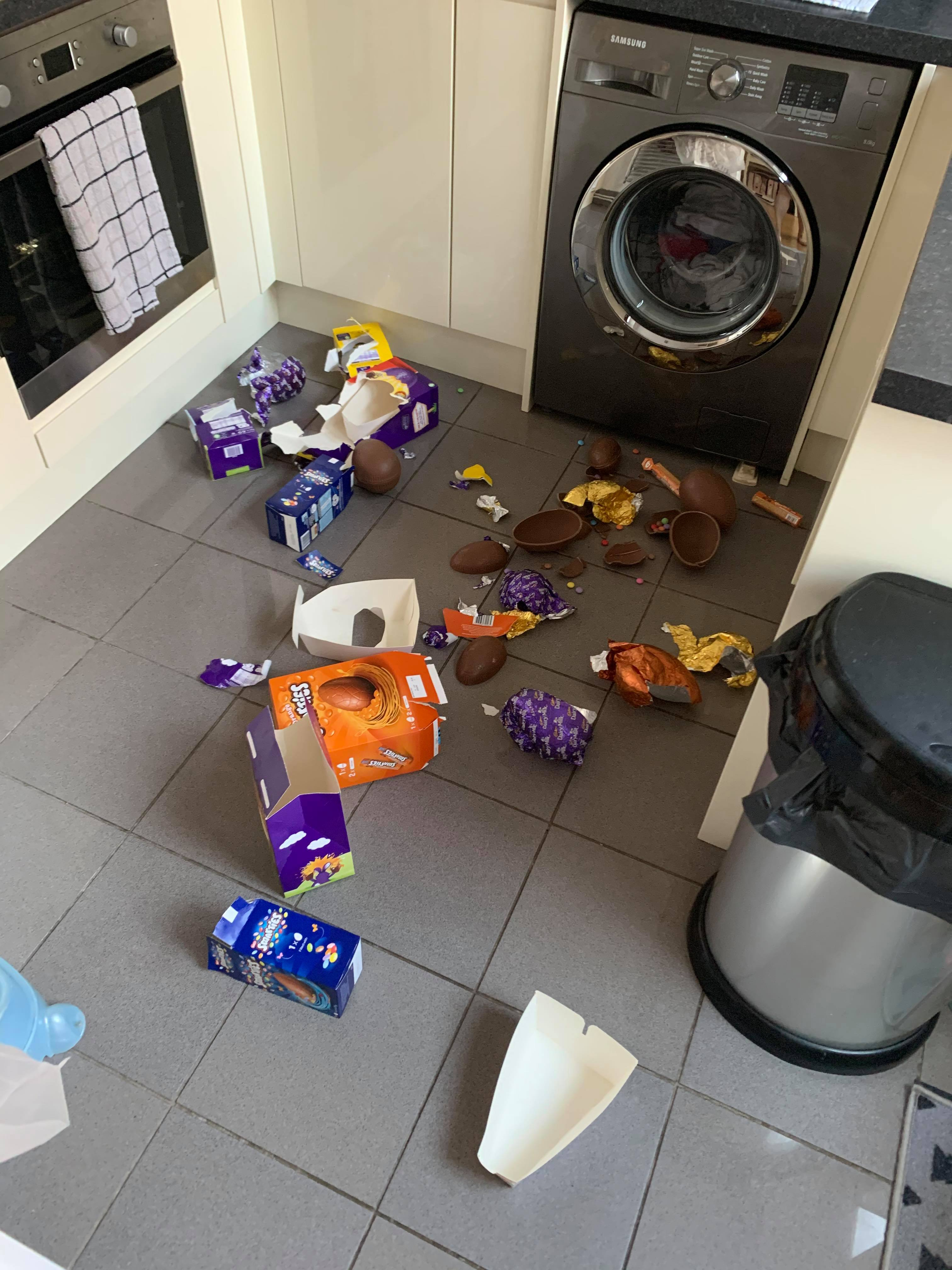 Easter eggs scattered on floor after toddler takes a bite out of every one