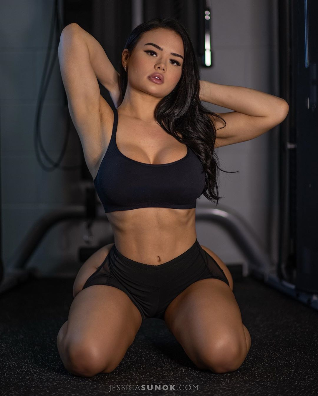 Christian model poses in workout gear