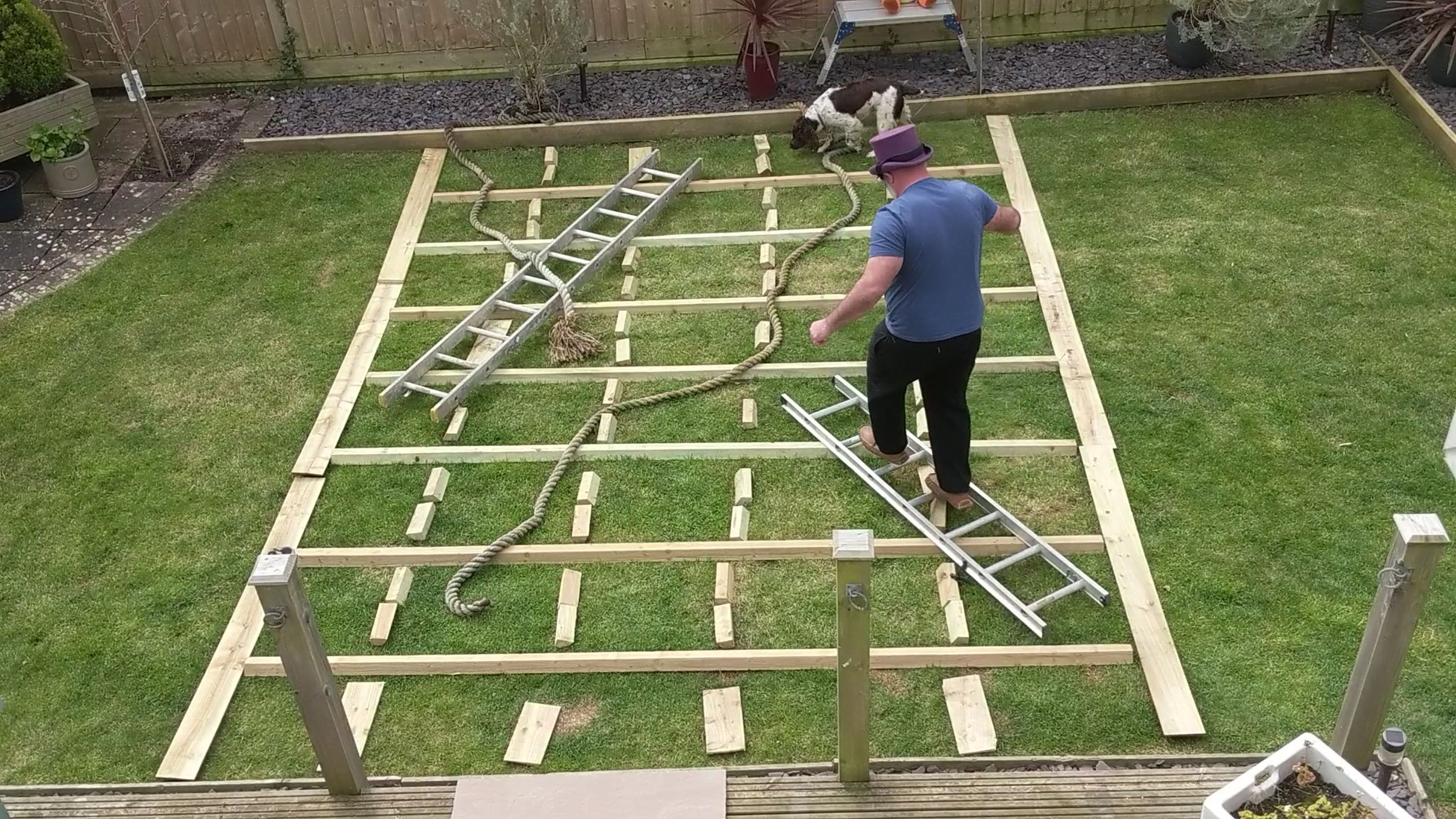 Granddad playing snakes and ladders in his back garden