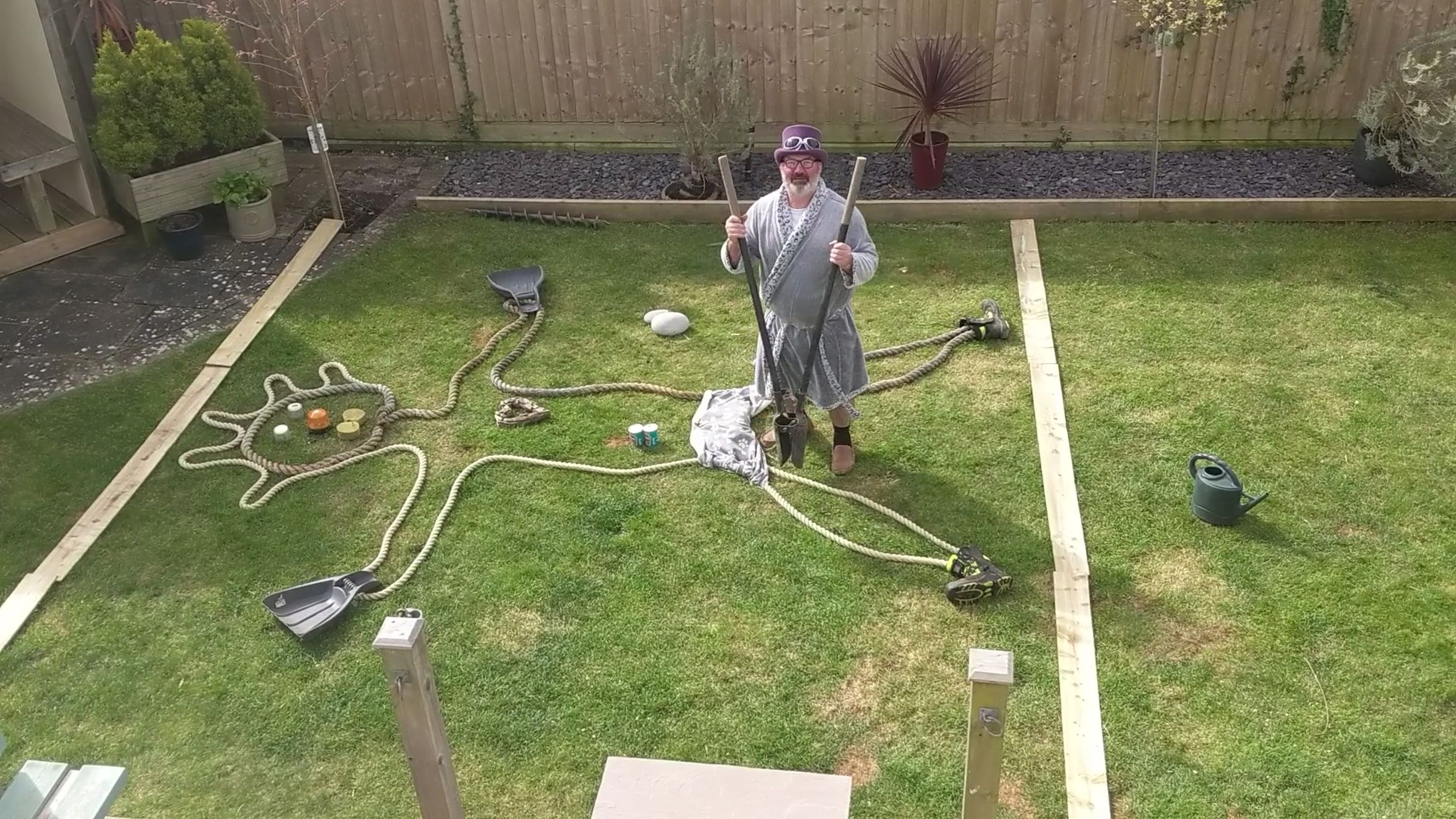 Granddad playing operation in his garden