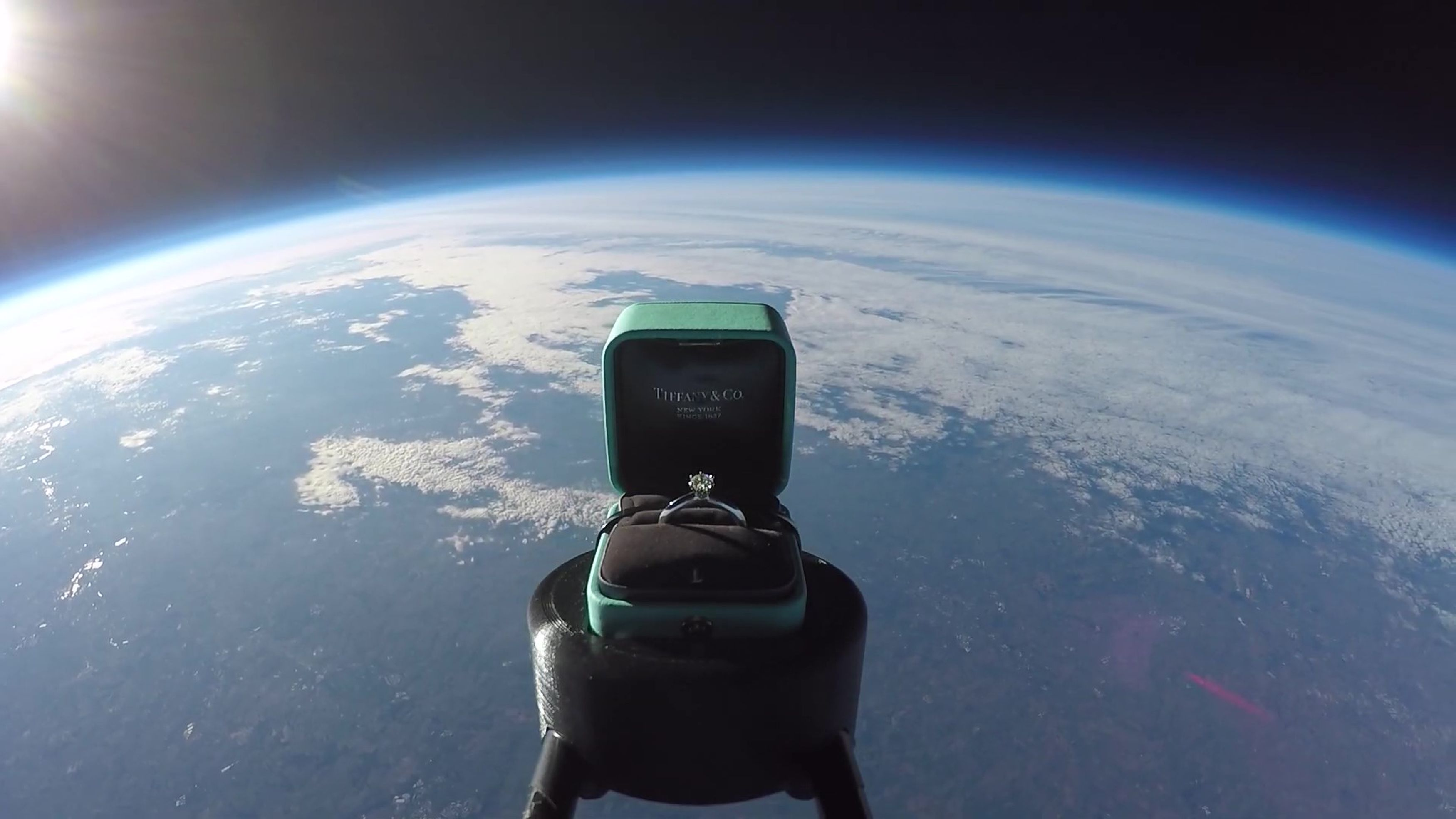 man proposes to girlfriend by sending ring into space