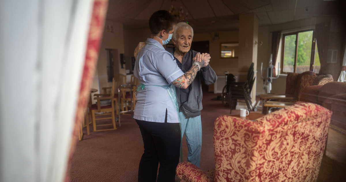 Moving Moment Carer Dances With Resident In Home Hit By Virus Days Before He Went Home After Surviving