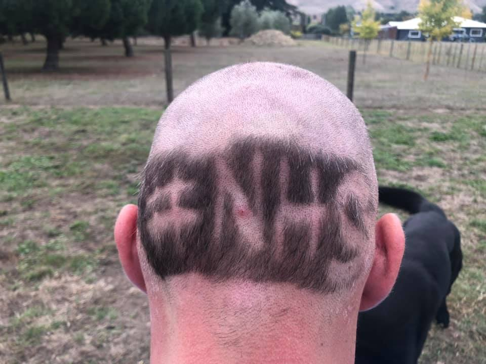 guy shaves nhs into head